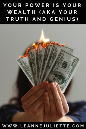 Your power is your wealth - person setting fire to money to show fire power