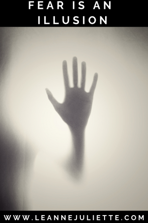 shadow hand on glass door to represent fear and illusion