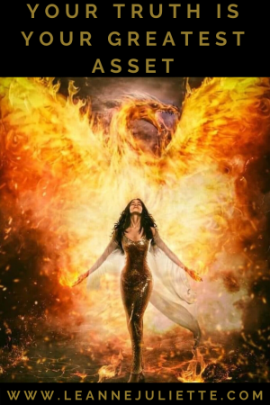 Woman walking through fire as phoenix rising with her truth